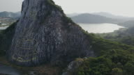 Carved buddha image from gold on the cliff at Khao Chee chan video