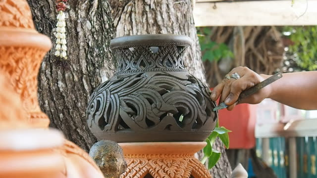 Carving clay pot on a potter video