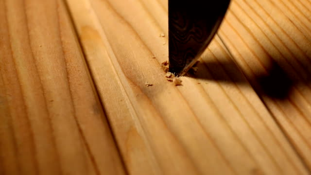 Carving on the wooden planks. video