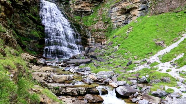 Cascada Cola de Caballo waterfall under Monte Perdido at Ordesa Valley Aragon Huesca Pyrenees of Spain video