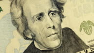 Cash money background. Andrew Jackson portrait on 20 US dollar bill close up rotation video
