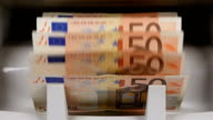 Cash money counting machine. Banknote counter are counting fifty euro bills video