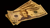 Cash money dollars bills banknotes spinning slowly video