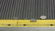 Cash money on escalator. Hundred dollar bills & coins. Currency. video