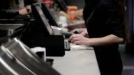 Cash register in the shop. Employees and buyers video