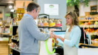 Cashier helping customer at the supermarket video