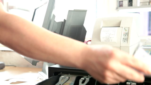 Cashier working at a petrol station video