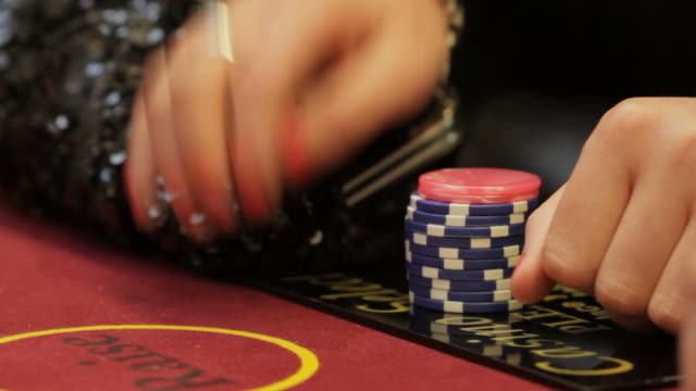 Casino chips and hands placing bet video