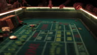 Casino footage, gambling chips and dice on craps table video