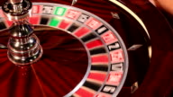 Casino roulette in motion, the spinning wheel ball and croupier hand video