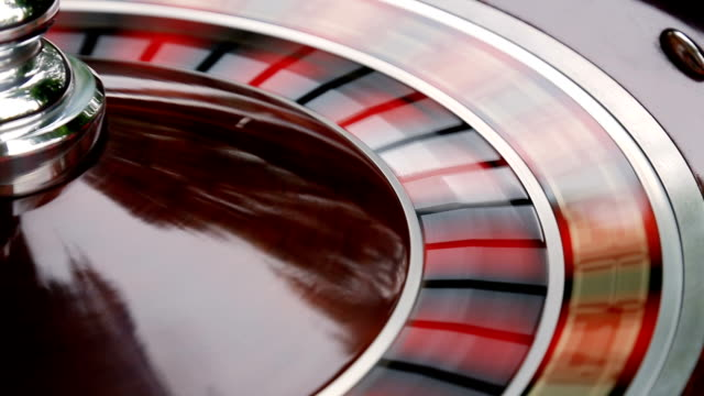 casino roulette wheel in motion. numbers on the roulette wheel close-up video