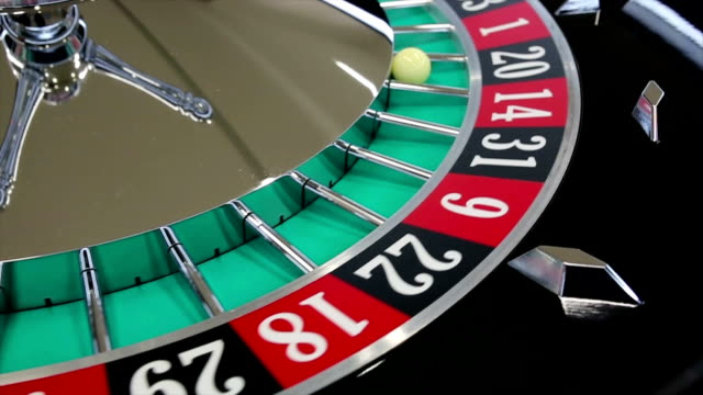 Casino roulette wheel with the ball on number 20 video