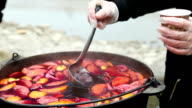 Cast iron pot with mulled wine video