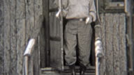 1938: Cast of characters exiting a vacation log cabin. video
