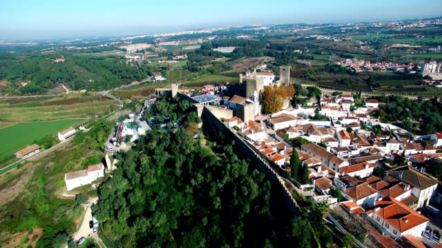 Castle on the hill Obidos Portugal aerial video