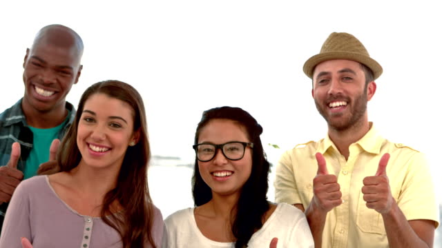 Casual business people with thumbs up video