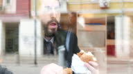 Casual businessman eating fast food video