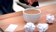 Casual businessman stiring his coffee video