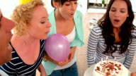 Casual people celebrating birthday in living room video