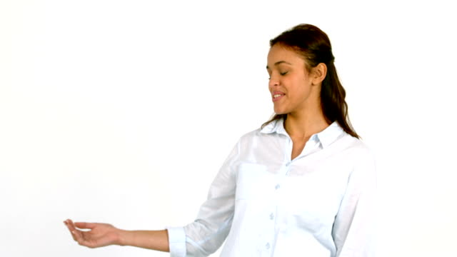 Casual woman presenting with hand video
