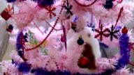 Cat playing on the pink Christmas tree video