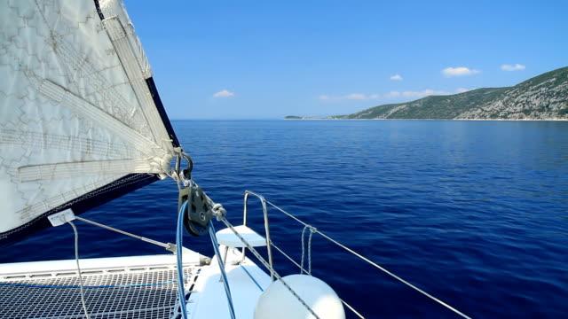 HD: Catamaran Sailing Along The Coast video