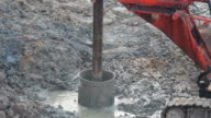 Caterpillar machine dig hole for piling video