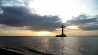 Catholic cross in the sea video