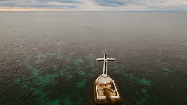 Catholic cross in the sea video