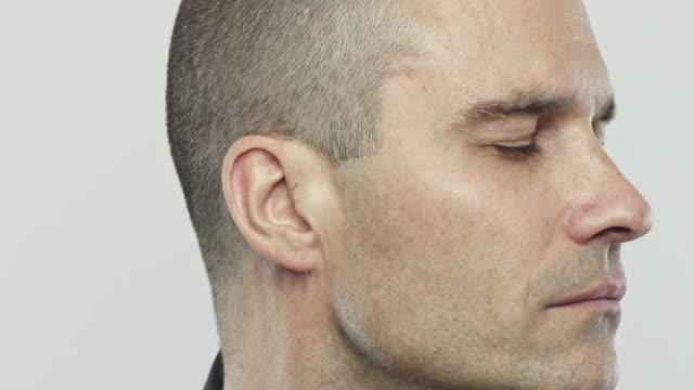 Caucasian adult man turning head and opening eyes video