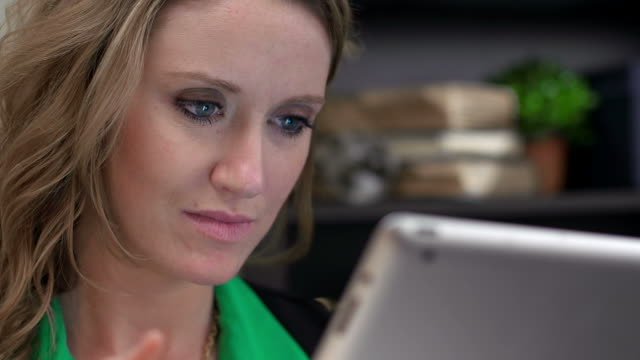 Caucasian business woman uses tablet at work video