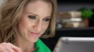 Caucasian business woman uses tablet video