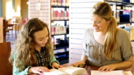 Caucasian female home school elementary student read to her Caucasian mid-adult mother or tutor video