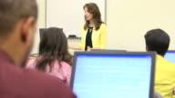 Caucasian Female Teaching Adult Students - MS video