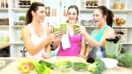 Caucasian Females Blender Fresh Vegetable Drink After Workout video
