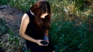 Caucasian girl uses a smartphone outdoor video
