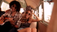 Caucasian Hipster Woman Smiles at Mixed Race Man Playing Guitar video