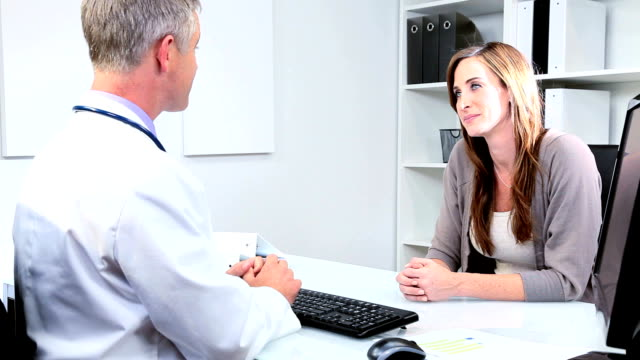 Caucasian Male Doctor Greeting Female Patient video