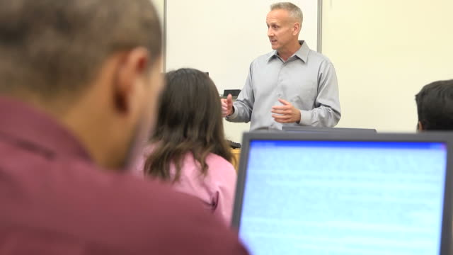 Caucasian Male Teaching Adult Students - MS video