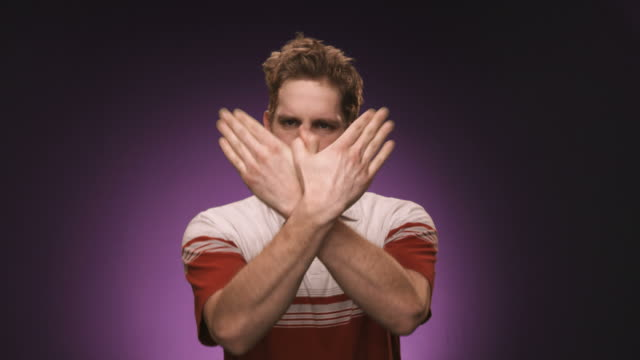Caucasian man makes silly hand gestures video