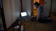 DS Caucasian man using computer in tatami house video