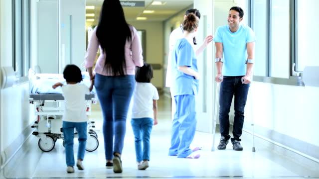Caucasian Nursing Staff Talking Male Patient Crutches video