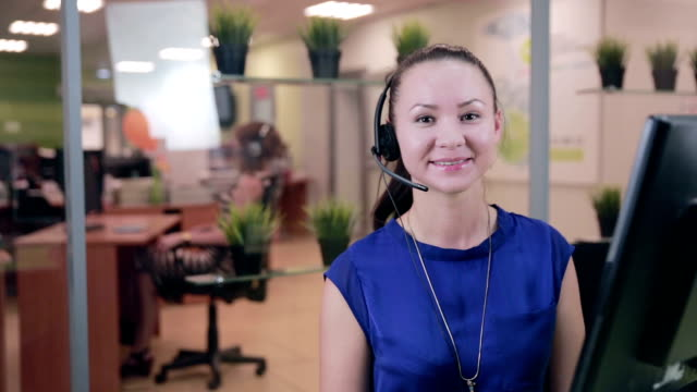 Caucasian woman at a Call center in a bright clean office video