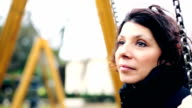 Caucasian woman female sad worried face in a park. Slowmotion video