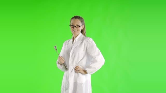 caucasian woman greenscreen cut out labcoat scientist video