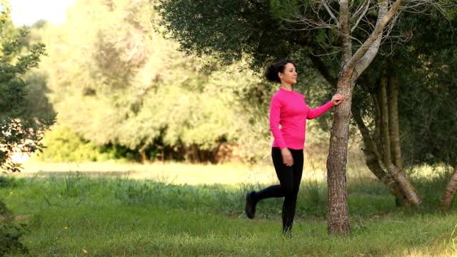 caucasian women doing streching exercising in the park video