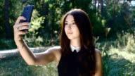 caucassian girl doing selfie on her smartphone outdoor video