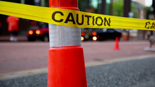 Caution safety tape. Road reconstruction video