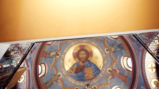 Ceiling with murals and chandelier in Church video
