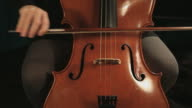 Cellist Playing Cello With Bow, frontal view video